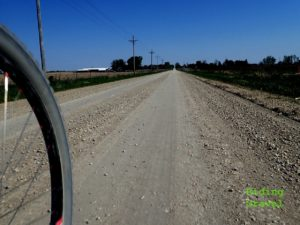 Shot of gravel road and wheel
