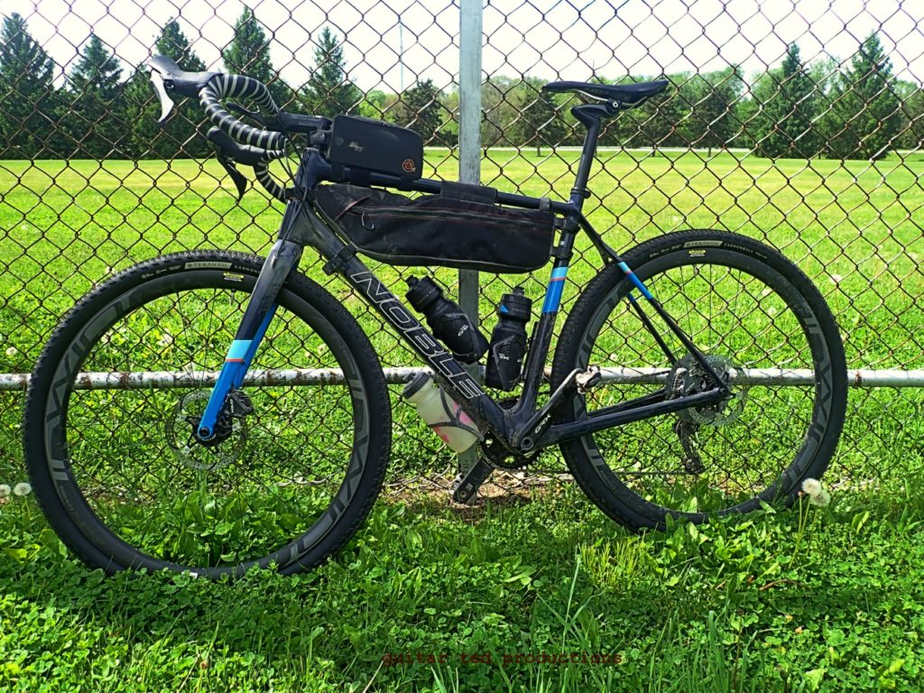 Bicycle against a chain link fence
