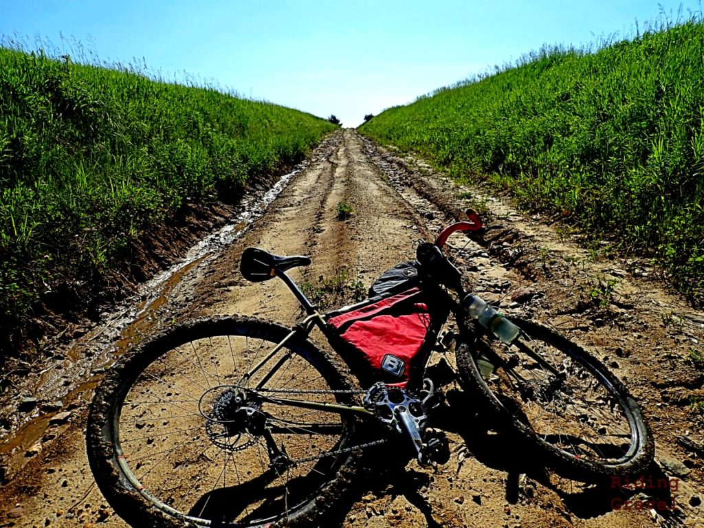 A bicycle on a dirt road.