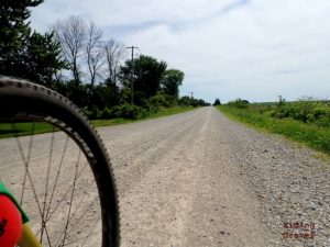 Image of a wheel and a gravel road