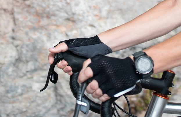 Image showing hands with cycling gloves gripping handlebars