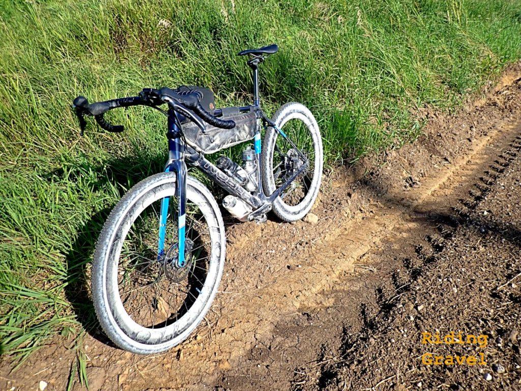 A dusty bike on a rural dirt road.