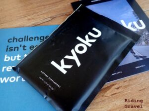 Close up of a Kyoku shake packet, encouraging card, and brochure.