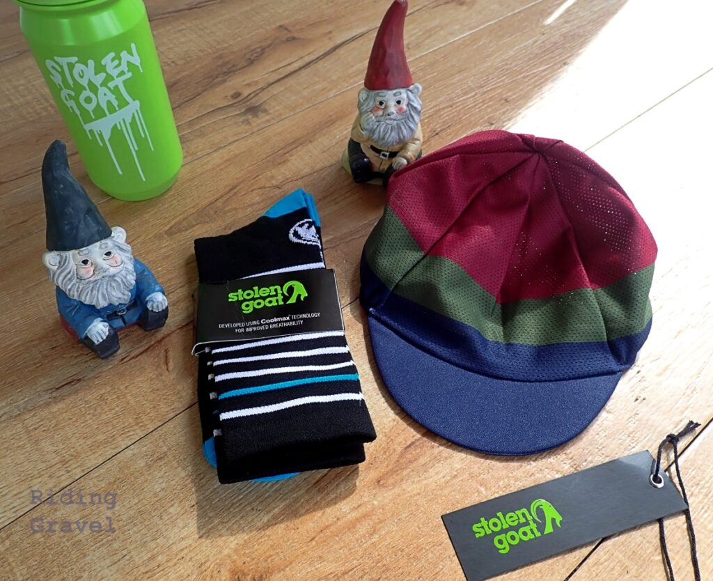 The Stolen Goat accessories we were sent: A pair of socks, a water bottle, and a cycling cap.