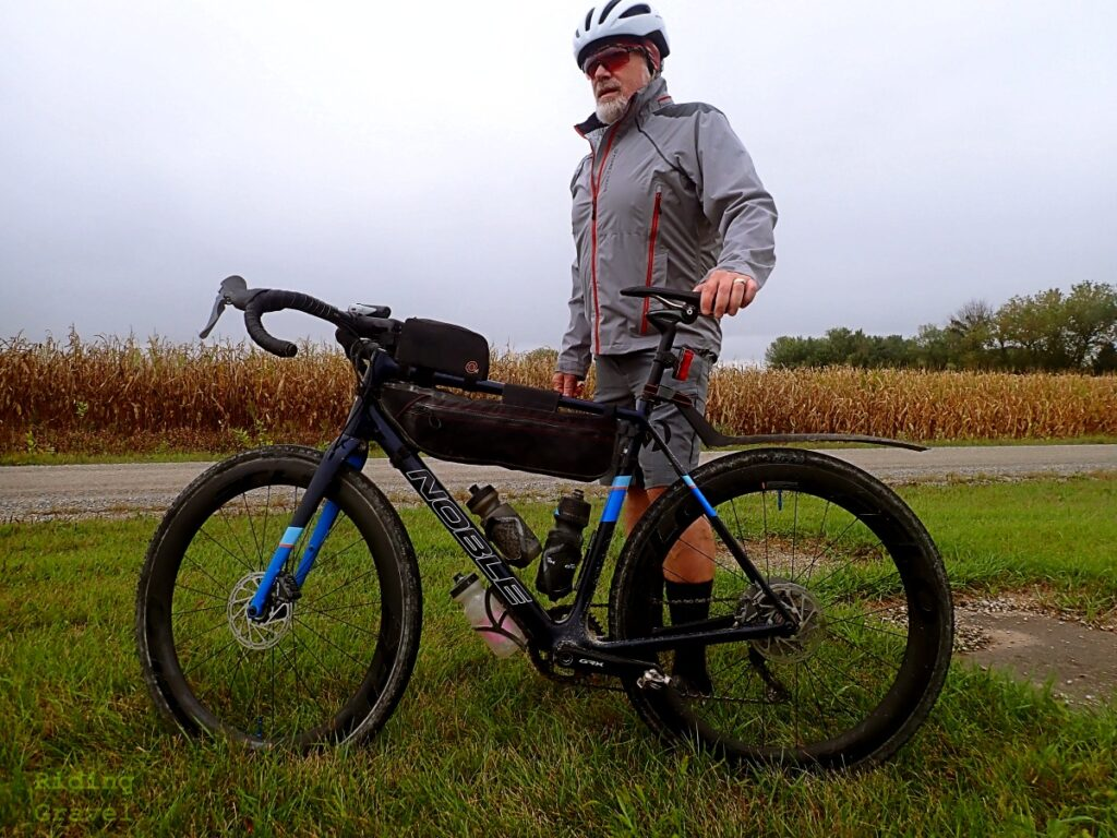 Guitar Ted, with bike, in a rural setting wearing the Cutline Glasses