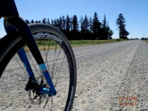 Wheel on a bike on a gravel road