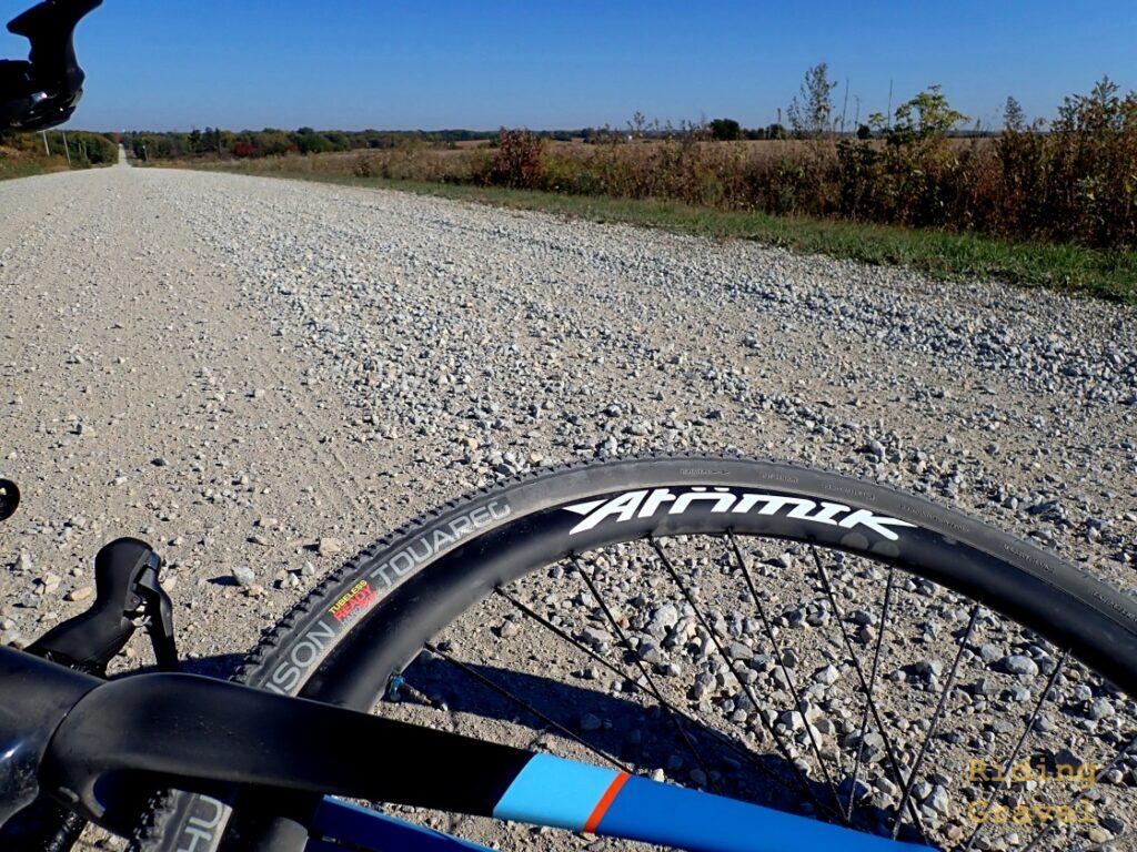 Atomik/Berd Ultimate wheel on a gravel road