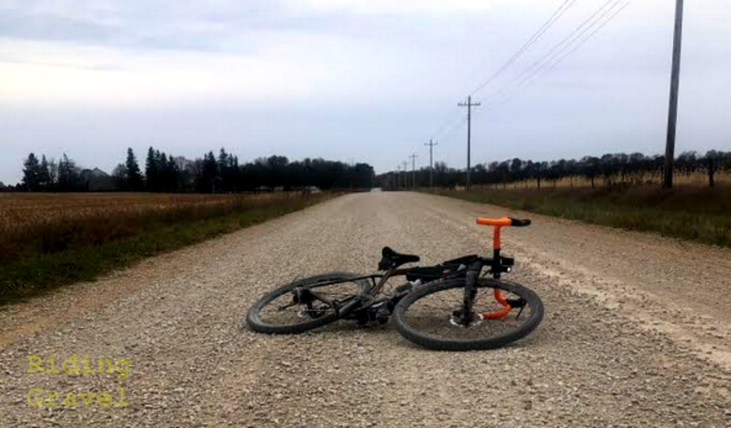 A bike laying on a gravel road