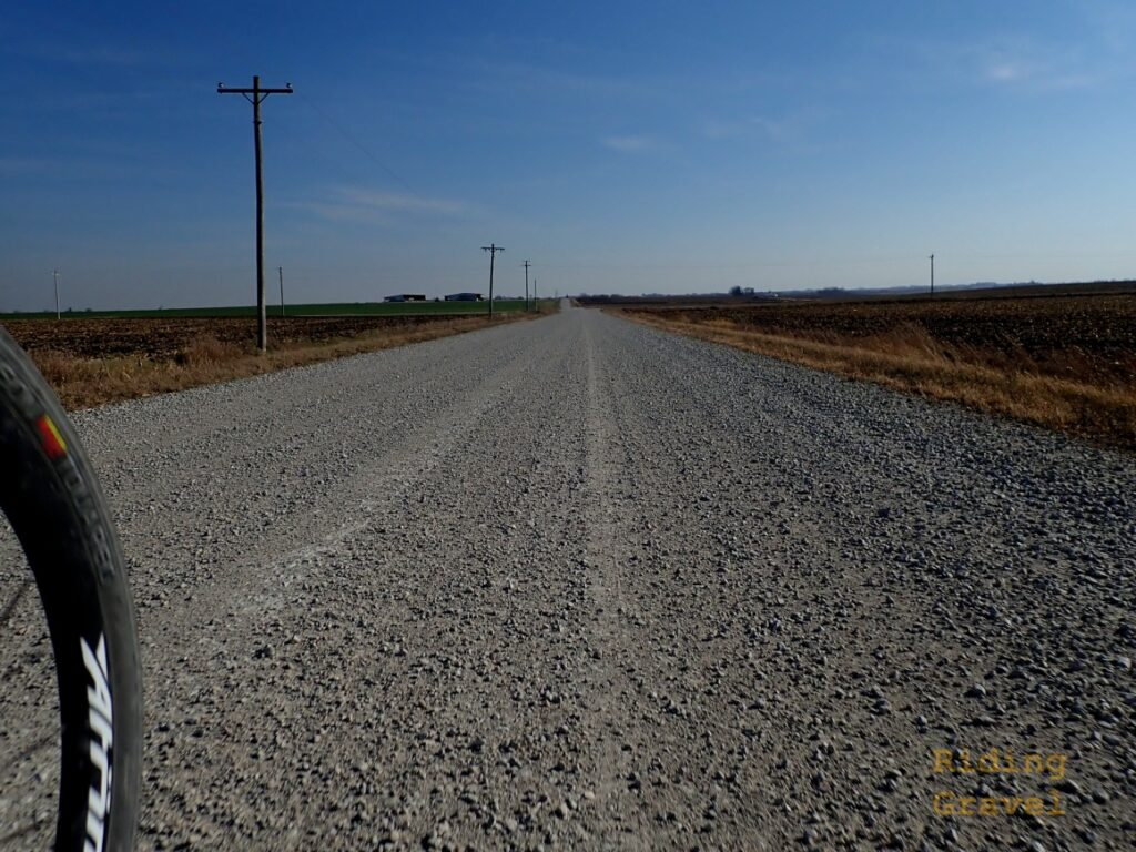 A gravel road and a detail of a Atomik/Berd Ultimate wheel.
