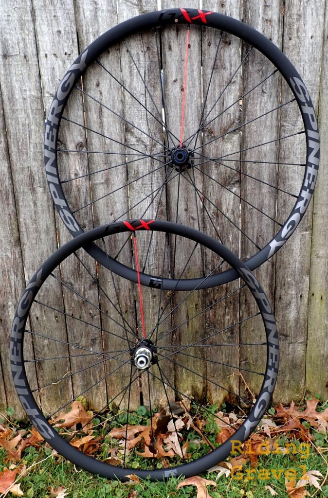 Spinergy GXX wheels against a wooden fence