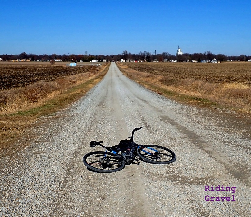 Bicycle laying on a gravel road