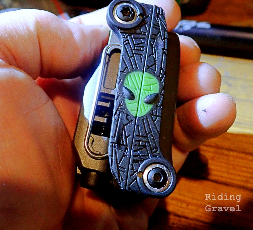 A Topeak Alien X multi-tool in hand
