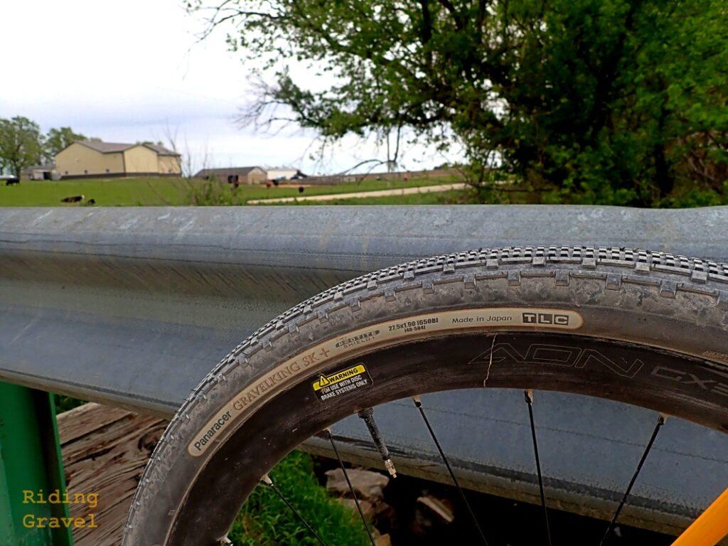 Detail of the Panaracer Gravel King SK+ tire in a rural setting