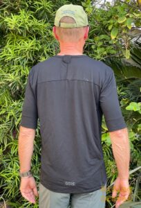 Grannygear models the GORE Explore shirt for men as seen from the back