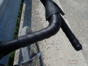 The Wolf Tooth Supple Lite Handle Bar Tape on a bike in a rural setting