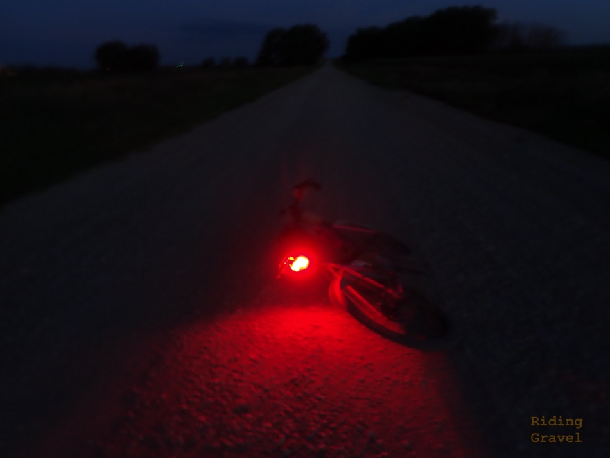 The CL06 Ravemen tail light in a rural setting at night.