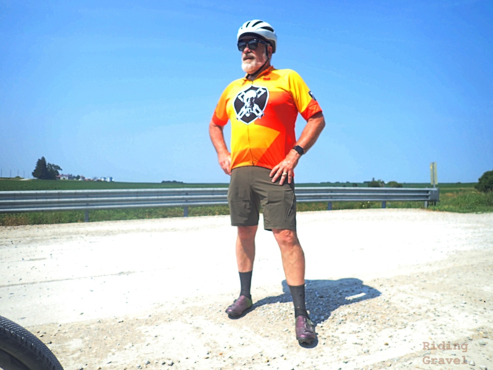 Guitar Ted modeling the Showers Pass Gravel Shorts somewhere in Iowa on a rural road