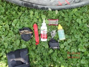Repair items lying on the ground which the author was able to put into the KOM Saddle Tool Roll