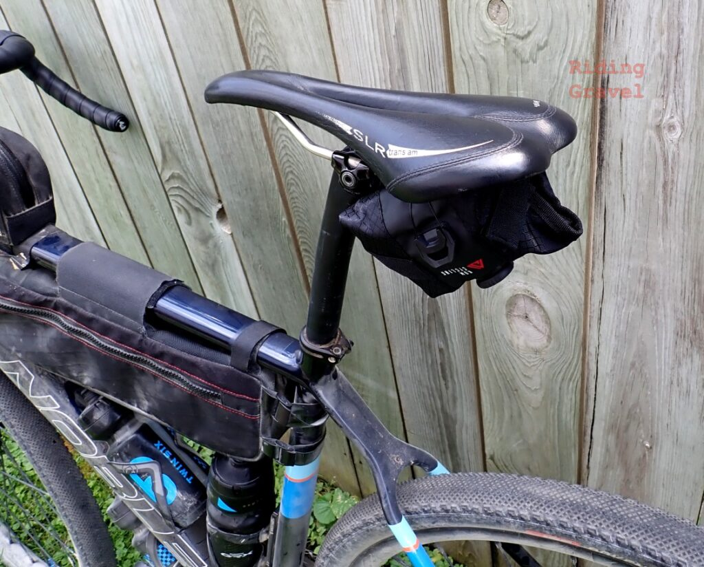 The KOM Saddle Tool Roll attached to a bicycle.