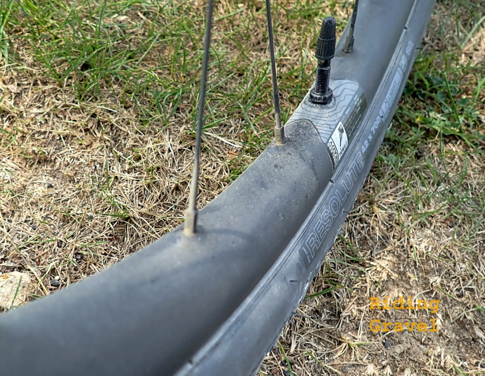 A detail shot of a CZR wheel showing the offset spoke bed and reinforced spoke nipple holes in a rural setting