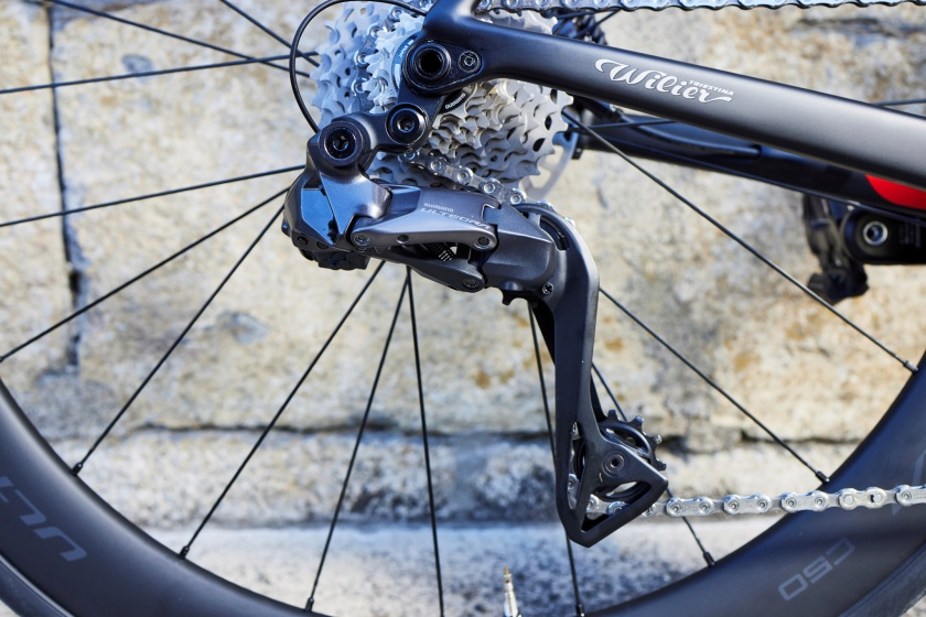 A view of a new 12 speed Shimano Ultegra Di2 rear derailleur and cassette on a road bike for our gravel tech feature