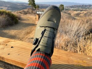 Grannygear lifts a left shoe out in the SoCal country