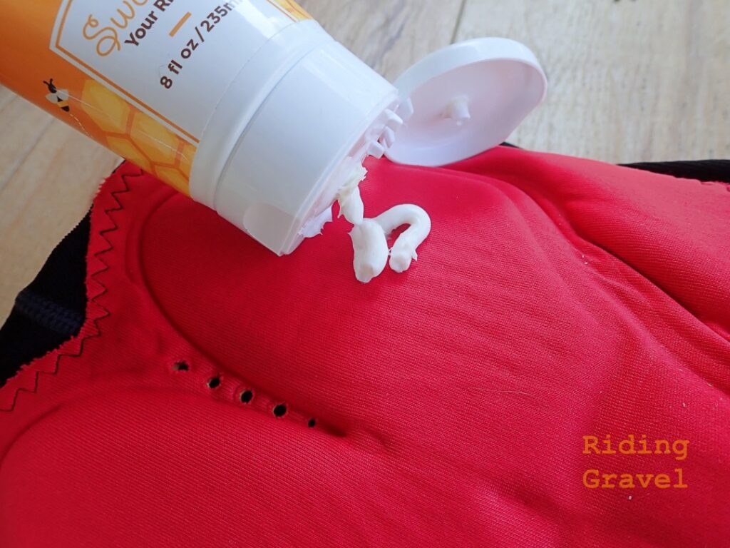 Image showing application of Honeybutt Chamois Creme to a bicycle short insert