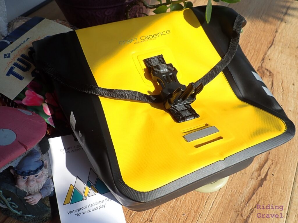 Craft Cadence Handlebar Bag on a table with other items