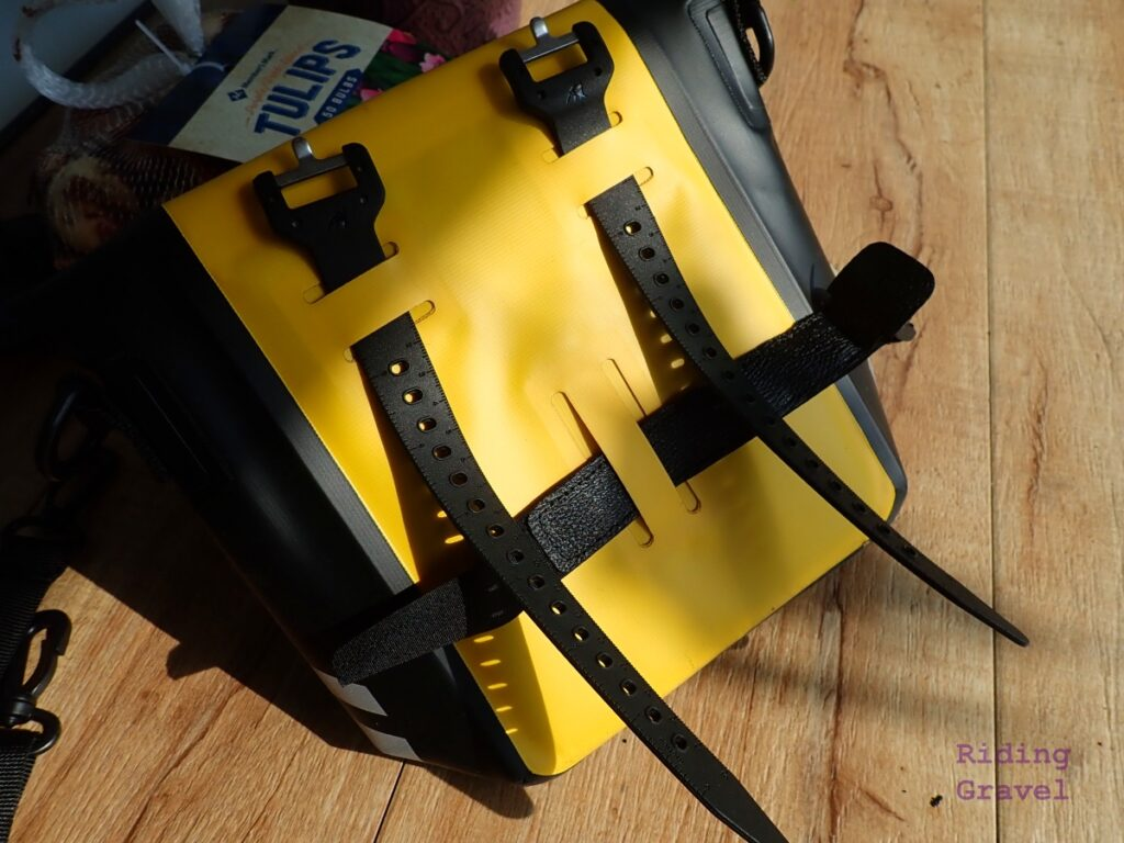 The backside of the Handle Bar Bag showing the mounting straps in their slots.