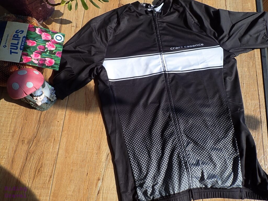 Craft Cadence Recycled performance Jersey on a table with other items