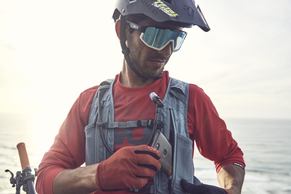 Image of a man with the EVOC HYDRO PRO vest on