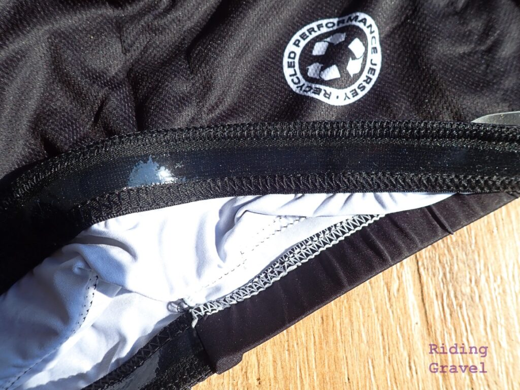 Detail on the Craft Cadence Recycled Performance Jersey showing the silicone gripper at the lower hem.